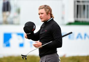 NEWCASTLE, NORTHERN IRELAND - MAY 30:  Eddie Pepperell of England walks off the 18th green during the Third Round of the Dubai Duty Free Irish Open Hosted by the Rory Foundation at Royal County Down Golf Club on May 30, 2015 in Newcastle, Northern Ireland.  (Photo by Ross Kinnaird/Getty Images)