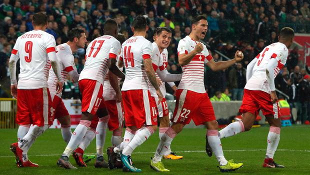 Switzerland players celebrate after Ricardo Rodriguez (obscured) scores his side's first goal of the game from the penalty spot during the 2018 World Cup Qualifying Play-Off, First Leg match at Windsor Park, Belfast. PRESS ASSOCIATION Photo. Picture date: Thursday November 9, 2017. Niall Carson/PA Wire.