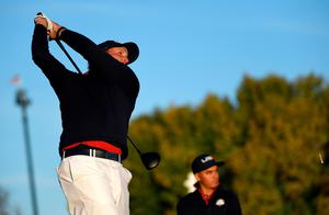CHASKA, MN - OCTOBER 01:  Phil Mickelson of the United States hits off the second tee as Rickie Fowler looks on during morning foursome matches of the 2016 Ryder Cup at Hazeltine National Golf Club on October 1, 2016 in Chaska, Minnesota.  (Photo by Ross Kinnaird/Getty Images)