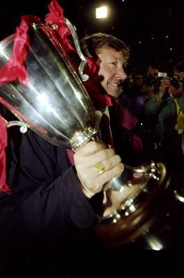 (FILE PHOTO) Manchester United manager Sir Alex Ferguson has announced that he will retire at the end of the season after 26 years in charge. 15 May 1991:  Portrait of Manchester United Manager Alex Ferguson with the trophy after the European Cup Winners Cup final against Barcelona at the Feyenoord Stadium in Rotterdam, Holland. Manchester United won the match 2-1. \ Mandatory Credit: David  Cannon/Allsport