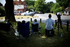 BUCKLEBURY, ENGLAND:  Members of the media sit near shops in the village of Bucklebury as the UK prepares for the birth of the first child of The Duke and Duchess of Cambridge on July 18, 2013 in Bucklebury, England, where the family of the Duchess of Cambridge live. (Photo by Peter Macdiarmid/Getty Images)