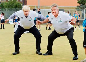 Mayor of London Boris Johnson (left) with England Rugby World Cup winner Jason Leonard before a practice rugby match with students at the Haverstock School in Camden, London, where the mayor launched a ?100,000 fund to boost grassroots participation in the sport. PRESS ASSOCIATION Photo. Picture date: Friday September 18, 2015. Photo credit should read: John Stillwell/PA Wire
