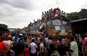 Bangladeshi Muslims try to board a packed train for homebound ahead of Eid al-Fitr as others wait at a railway station in Dhaka, Bangladesh, Thursday, Aug. 8, 2013. The mass exodus out of the capital and other major cities in the country is underway as millions are heading back to their home towns to celebrate Eid al-Fitr holiday which marks the end of the holy fasting month of Ramadan. (AP Photo/A.M. Ahad)