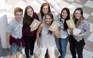 A Level student's at  Banbridge academy, Co Down celebrate getting their results. Pictured is Joseph Baird with Meagan Mckinstry, Katy lyttle, Sarah Kyle and Ciara Kennedy with Rachel Jardine. Picture Mark Marlow
