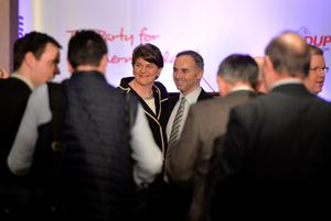 BELFAST, NORTHERN IRELAND - DECEMBER 17:  DUP leader in waiting Arlene Foster poses for photographs with party colleagues at the Park Avenue hotel ahead of the Democratic Unionist Party electoral college meeting on December 17, 2016 in Belfast, Northern Ireland. Arlene Foster, who will succeed Peter Robinson becomes the first female leader of the Democratic Unionist Party. No other nominations were put forward for the role of leader. Mrs Foster will also be appointed as the new Northern Ireland first minister in the coming weeks. The former Ulster Unionist Party member has enjoyed a rapid rise through the ranks of the DUP following her defection in 2004, twice standing in as temporary first minister for Peter Robinson in times of personal and political crisis. The DUP remain the largest political party within the provinces' Executive government.  (Photo by Charles McQuillan/Getty Images)