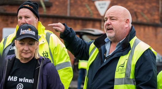 (Front left to right) Harland and Wolff worker Joe Passmore and Denise Walker of GMB union, along with fellow worker Barry Reid (rear left) speak to workers and supporters: Tuesday October 1, 2019.