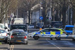 The silver Volkswagen Polo (left) where Abdul Deghayes was found injured (Gareth Fuller/PA)