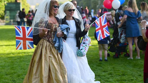 It's a nice day for a white wedding for these two spectators (David Mirzoeff/PA)