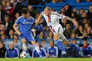 LONDON, ENGLAND - SEPTEMBER 18:  Ivan Ivanov of FC Basel pulls on the shirt of Oscar of Chelsea during the UEFA Champions League Group E Match between Chelsea and FC Basel at Stamford Bridge on September 18, 2013 in London, England.  (Photo by Ian Walton/Getty Images)