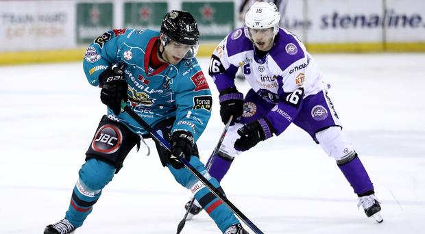Belfast Giants hat-trick hero Rickard Palmberg is chased down by Glasgow Clan's Rasmus Bjerrum during Friday night's game at the SSE Arena (William Cherry/Presseye)