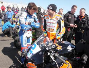 Northern Ireland- 14th May 2013 Mandatory Credit - Photo-Jonathan Porter/Presseye.  The Vauxhall International North West 200 - First practice day.   Guy Martin(left) and Bruce Anstey on the grid before the start of the Supersport practice.