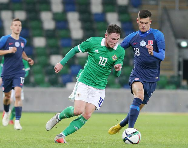 Press Eye - Belfast - Northern Ireland - 16th October 2018  European U21 Championship 2019 Qualifying Round at the National Stadium art Windsor Park.  Northern Ireland Vs Slovakia.   Northern Ireland's Jordan Thompson with Slovakia's Christain Herc.  Picture by Jonathan Porter/PressEye