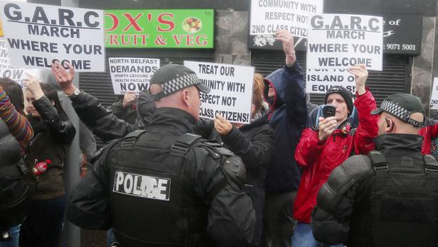 Press Eye - Belfast -  Northern Ireland - 13th July  2015  Nationalist protest and heavy police presence at the Ardoyne Shops on the Crumlin Road in north Belfast as an Orange Order feeder parade makes its way to the City Centre for the main 12th of July parade.     Picture by Jonathan Porter/Press Eye