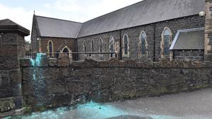 The scene of a paint bomb attack at St MacNissi's Parish Church in Larne. Credit: Colm Lenaghan/Pacemaker Press