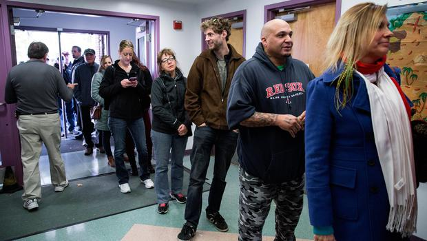 NASHUA, NH - NOVEMBER 8: New Hampshire citizens stand in line to cast their vote at Amherst Street Elementary School on November 8, 2016, in Nashua, New Hampshire. Americans today will choose between Republican presidential candidate Donald Trump and Democratic presidential candidate Hillary Clinton as they go to the polls to vote for the next president of the United States. (Photo by Kayana Szymczak/Getty Images)