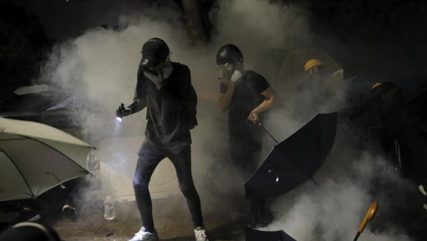 Students targeted with tear gas (Kin Cheung/AP)