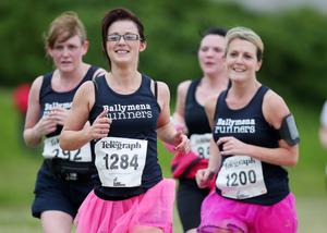 Belfast Telegraph RunHer 10k coastal challenge from Seapark to Crawfordsburn.  The runners make their way along the beach at Helen's Bay.