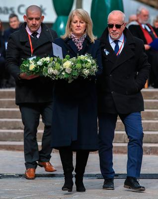 Wendy Parry and her husband Colin (right) lay flowers at the memorial stone on Bridge Street, in Warrington, where two IRA bombs were detonated, killing their son Tim Parry, 12, and Johnathan Ball, three, and injuring over fifty others, during the 25th anniversary service of the Warrington bombing attack. PRESS ASSOCIATION Photo. Picture date: Tuesday March 20, 2018. See PA story MEMORIAL Warrington. Photo credit should read: Peter Byrne/PA Wire