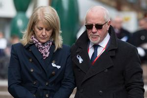 Wendy Parry and her husband Colin, after laying flowers at the memorial stone on Bridge Street, in Warrington, where two IRA bombs were detonated, killing their son Tim Parry, 12, and Johnathan Ball, three, and injuring over fifty others, during the 25th anniversary service of the Warrington bombing attack. PRESS ASSOCIATION Photo. Picture date: Tuesday March 20, 2018. See PA story MEMORIAL Warrington. Photo credit should read: Peter Byrne/PA Wire
