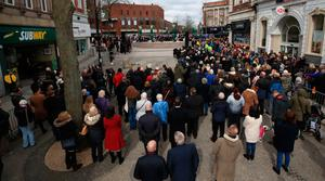 People gather at the memorial stone on Bridge Street, in Warrington, where two IRA bombs were detonated, killing their son Tim Parry, 12, and Johnathan Ball, three, and injuring over fifty others, during the 25th anniversary service of the Warrington bombing attack. PRESS ASSOCIATION Photo. Picture date: Tuesday March 20, 2018. See PA story MEMORIAL Warrington. Photo credit should read: Peter Byrne/PA Wire