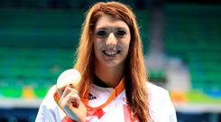 Great Britain's Bethany Firth with her Gold medal during the medal ceremony for the Women's 100m Backstroke S14 at the Olympic Aquatics Stadium during the first day of the 2016 Rio Paralympic Games in Rio de Janeiro, Brazil. PA