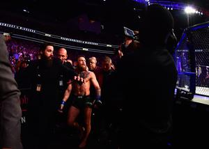 Conor McGregor is escorted out of the octagon after being defeated by Khabib Nurmagomedov.  (Photo by Harry How/Getty Images)