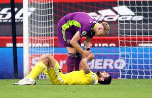Fulham's Aleksandar Mitrovic is consoled by Sheffield United goalkeeper Aaron Ramsdale after the striker missed a penalty and then conceded one in a 1-1 draw at Bramall Lane (PA)