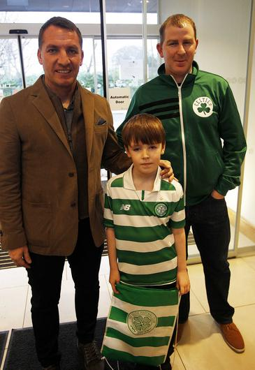 Brendan Rogers at the Northern Ireland Hospice on Christmas with young Celtic fan Riley Corbett and his dad Tony
