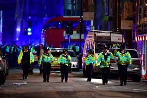 """Police officers on Borough High Street as police are dealing with a """"major incident"""" at London Bridge. Photo: Dominic Lipinski/PA Wire"""