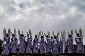 Women dressed as angels gather to pose for a group photo before the annual Easter procession during traditional Semana Santa (Holy Week) festivities on April 5, 2015 in Ouro Preto, Brazil. (Photo by Mario Tama/Getty Images)