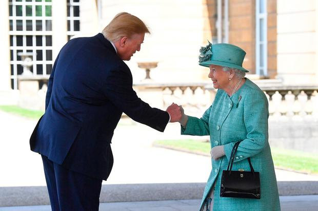 Queen Elizabeth greets US President Donald Trump as he arrives for the Ceremonial Welcome at Buckingham Palace, London, on day one of his three day state visit to the UK.