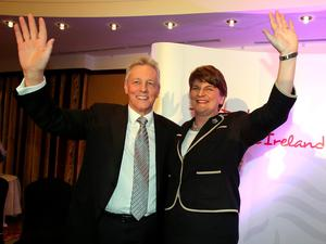 Former DUP leader Peter Robinson (L) and new leader Arlene Foster, Northern Ireland Finance Minister in Belfast wave after the election contest for leader of the Democratic Unionist Party (DUP) on December 17, 2015. A special electoral college will gather at the hotel, and Foster is the only candidate for the leadership. Foster will replace Peter Robinson following his announcement that he will step down as Northern Ireland's First Minister and as leader of the DUP.  AFP PHOTO / PAUL FAITHPAUL FAITH/AFP/Getty Images