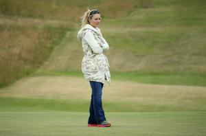 GULLANE, SCOTLAND - JULY 15:  Skier Lindsey Vonn watches Tiger Woods of the United States ahead of the 142nd Open Championship at Muirfield on July 15, 2013 in Gullane, Scotland.  (Photo by Andy Lyons/Getty Images)