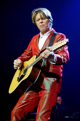 """(FILES) This file photo taken on September 24, 2002 shows British musician David Bowie performing in Paris. British rock music legend David Bowie has died after a long battle with cancer, his official Twitter and Facebook accounts said on January 11, 2016. Bowie died on Januray 10 surrounded by family according to his social media accounts. The iconic musician had turned 69 only on January 8, which coincided with the release of """"Blackstar"""", his 25th studio album. / AFP / MARTIN BUREAUMARTIN BUREAU/AFP/Getty Images"""