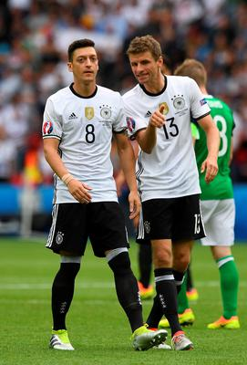 PARIS, FRANCE - JUNE 21: Mesut Ozil (L) and Thomas Muller (R) of Germany during the UEFA EURO 2016 Group C match between Northern Ireland and Germany at Parc des Princes on June 21, 2016 in Paris, France. (Photo by Charles McQuillan/Getty Images)