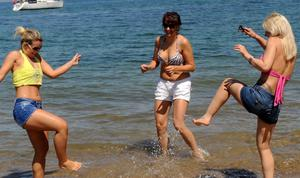 Pacemaker Press 8/7/2012   From L-R Gabriella Parozi, Eniko Kovacs and Andrea Zemen enjoying the weather at Helen's Bay in Co Down , as hot spells hit across Northern Ireland  Pic Colm Lenaghan/Pacemaker
