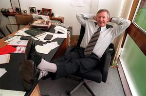 File photo dated 08/9/1998 of Alex Ferguson relaxes in his office. PRESS ASSOCITAION Photo. Issue date: Wednesday May 8, 2013. Sir Alex Ferguson will retire at the end of this season, Manchester United have announced. See PA Story SOCCER Man Utd. Photo credit should read: Malcolm Croft/PA Wire.