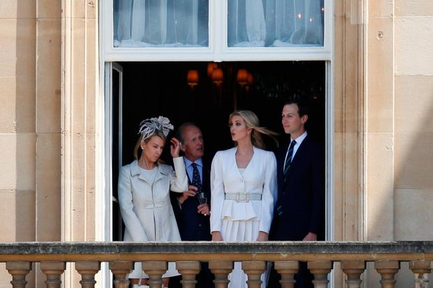 Ivanka Trump (2R) and her husband Senior Advisor to the President of the United States Jared Kushner (R) watch from a balcony as the US President Donald Trump and US First Lady Melania Trump arrive for a welcome ceremony at Buckingham Palace in central London on June 3, 2019, on the first day of their three-day State Visit to the UK.