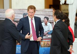 WASHINGTON, DC - MAY 09:  U.S. Sen. John McCain (R-AZ) (L) and HRH Prince Harry (2nd-L) tours an anti-landmine photography exhibition by The HALO Trust charity during the first day of his visit to the United States at the Russell Senate Office Building on May 9, 2013 in Washington, DC. HRH will be undertaking engagements on behalf of charities with which the Prince is closely associated on behalf also of HM Government, with a central theme of supporting injured service personnel from the UK and US forces.  (Photo by Chris Jackson-Pool/Getty Images)
