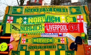 NORWICH, ENGLAND - JANUARY 23:  Matchday scarves are on sale at a stall outside the stadium prior to the Barclays Premier League match between Norwich City and Liverpool at Carrow Road on January 23, 2016 in Norwich, England.  (Photo by Clive Mason/Getty Images)