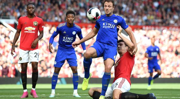 Jonny Evans of Leicester City is challenged by Harry Maguire of Manchester United. Credit: Gary Prior/Getty Images