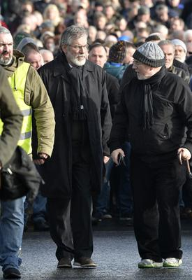 Mourners pictured at the removal of Sinn Feins Martin McGuinness to his home in the Bog side. Sinn Feins president Gerry Adams