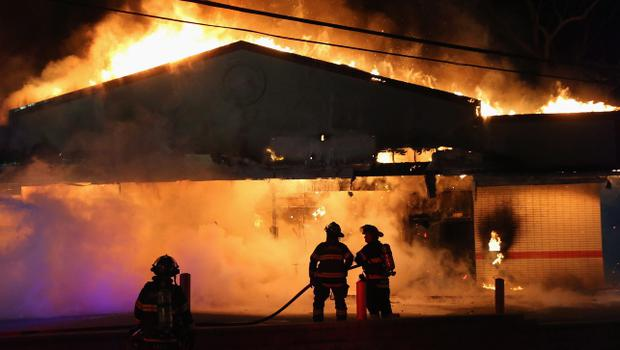 FERGUSON, MO - NOVEMBER 24:  A restaurant burns after it was set on fire when protestors rioted following the grand jury announcement in the Michael Brown case on November 24, 2014 in Ferguson, Missouri. Ferguson has been struggling to return to normal after Brown, an 18-year-old black man, was killed by Darren Wilson, a white Ferguson police officer, on August 9. His death has sparked months of sometimes violent protests in Ferguson. A grand jury today declined to indict officer Wilson.  (Photo by Scott Olson/Getty Images)