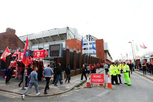 LIVERPOOL, ENGLAND - APRIL 14:  Fans walk outside the ground prior to the UEFA Europa League quarter final, second leg match between Liverpool and Borussia Dortmund at Anfield on April 14, 2016 in Liverpool, United Kingdom.  (Photo by Clive Brunskill/Getty Images)