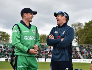 Flatmates turned foes: Porterfirled and Eoin Morgan share a joke at the coin toss ahead of an ODI between Ireland and England last year.