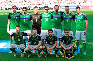 Northern Ireland's players pose ahead of the Euro 2016 group C football match between Poland and Northern Ireland at the Allianz Riviera stadium in Nice. / AFP PHOTO / TOBIAS SCHWARZTOBIAS SCHWARZ/AFP/Getty Images