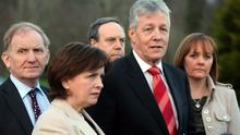 First Minister Peter Robinson (2nd right) speaks outside Stormont Castle