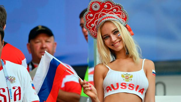 A Russia fan waves a Russian flag before the start of the Russia 2018 World Cup Group A football match between Uruguay and Russia at the Samara Arena in Samara on June 25, 2018.