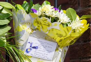 A floral tribute left at the gates of Connolly House, Andersonstown, Belfast following the death of Northern Ireland's former deputy first minister and ex-IRA commander Martin McGuinness aged 66. Liam McBurney/PA Wire