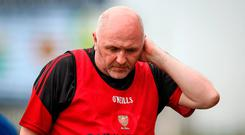 Sad exit: Down boss Ronan Sheehan was left dejected after their defeat